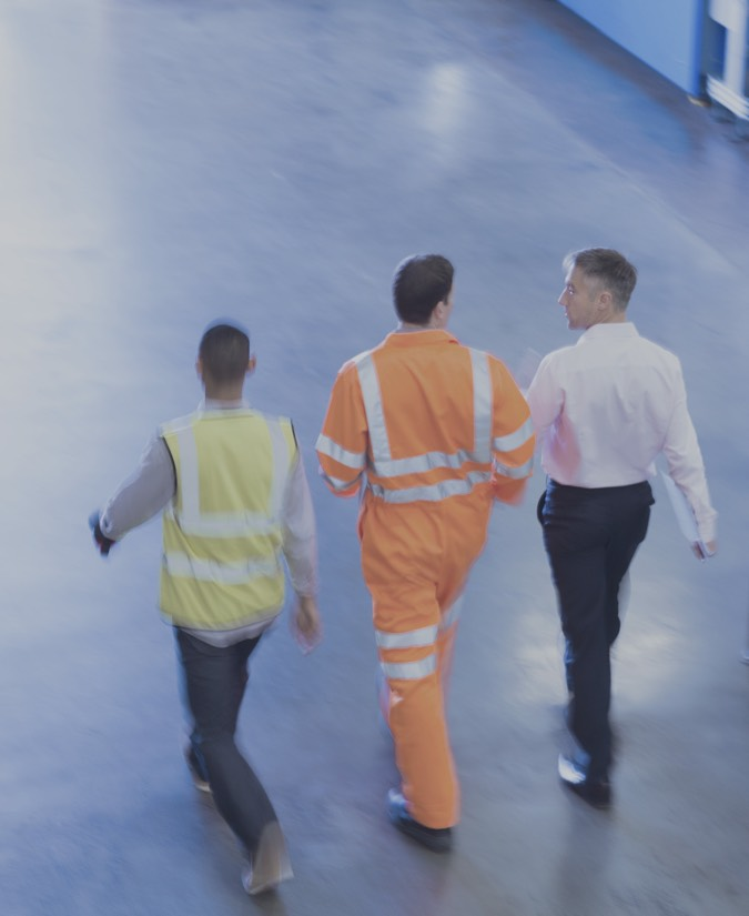 workers-in-reflective-clothing-walking-in-factory-2